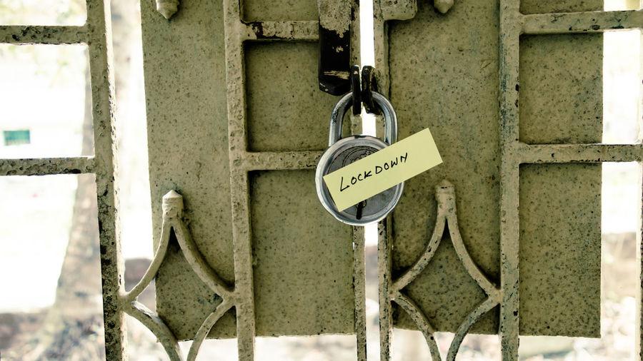 Close-up of padlocks hanging on metal