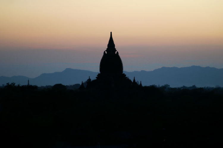 Silhouette of temple against sky during sunset