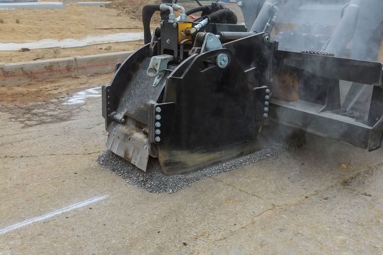 Machine part on road in city