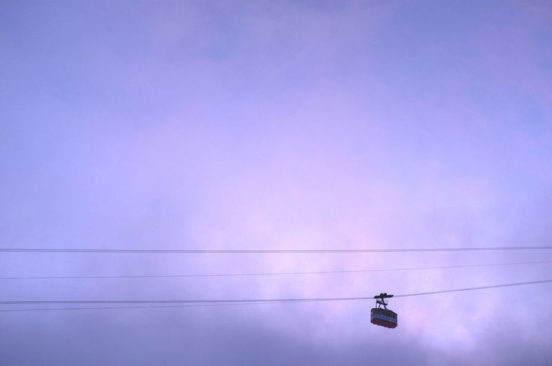 Low angle view of cable car against sky