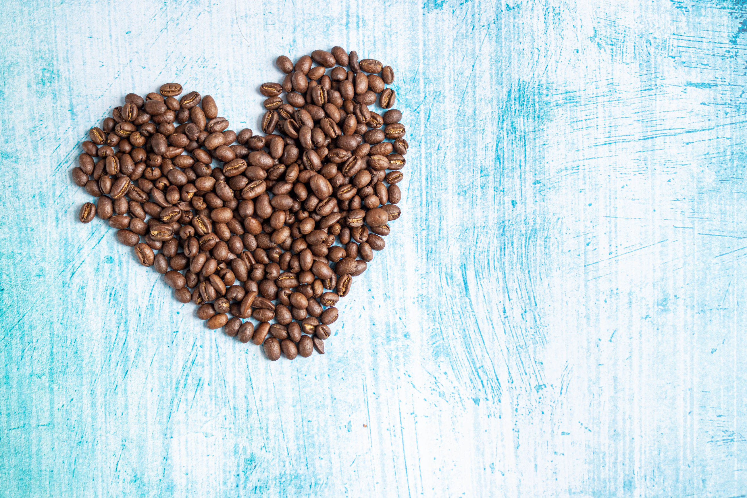 food and drink, food, directly above, large group of objects, blue, coffee, coffee - drink, indoors, abundance, roasted coffee bean, freshness, no people, studio shot, copy space, wood - material, high angle view, brown, heart shape, still life, love, positive emotion