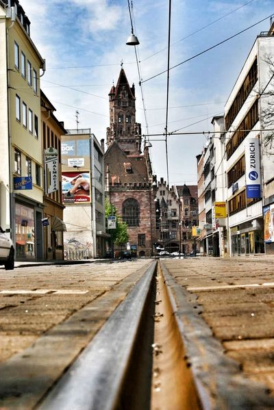 Saarbruecken Architecture Building Exterior Built Structure Street Surface Level Transportation Railroad Track City Sky The Way Forward Long Tower Day Outdoors Cloud - Sky City Life Spire  Old Town Diminishing Perspective Town