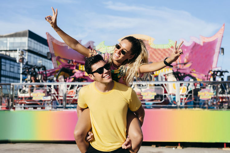 Young man and woman wearing sunglasses