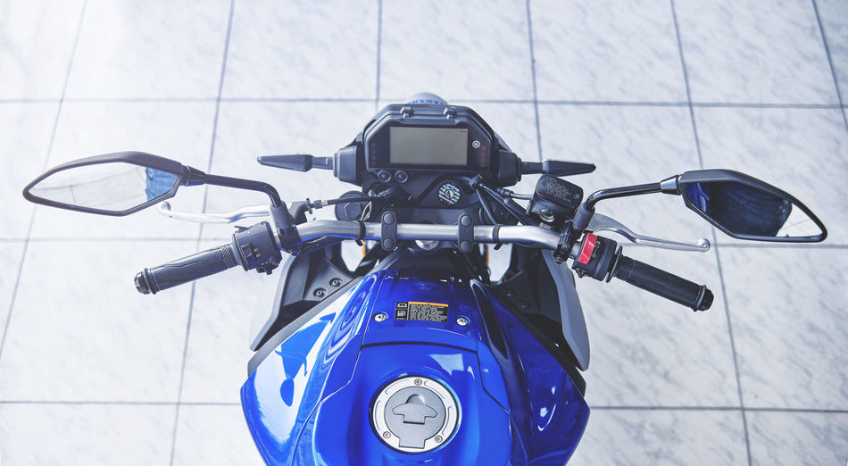 High angle view of motor scooter on tiled floor