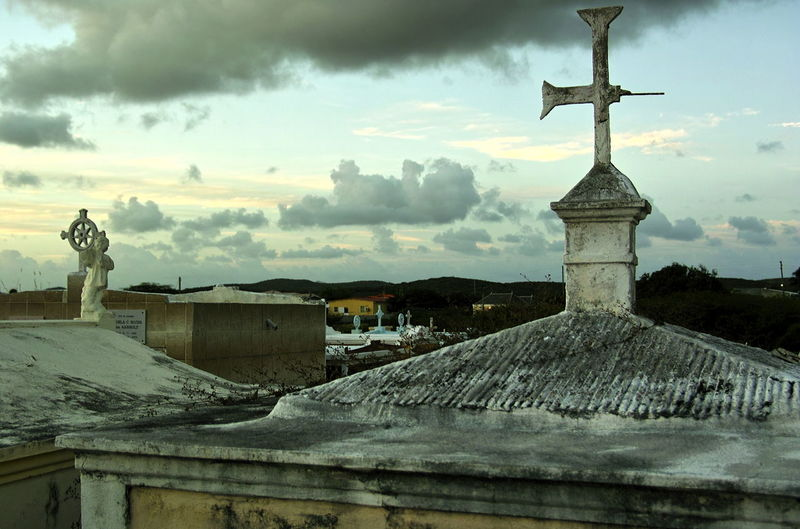 the sun sets over the old cemetery of St. Willibrordus, Curaçao Architecture Building Exterior Built Structure Cloud - Sky Clouds Cross Crosses & Headstones Curacao Day Graves Graves Before Horizon Gravestones Graveyard Graveyard Beauty Mausoleae Mausoleum No People Outdoors Place Of Worship Religion Sky Spirituality Statue