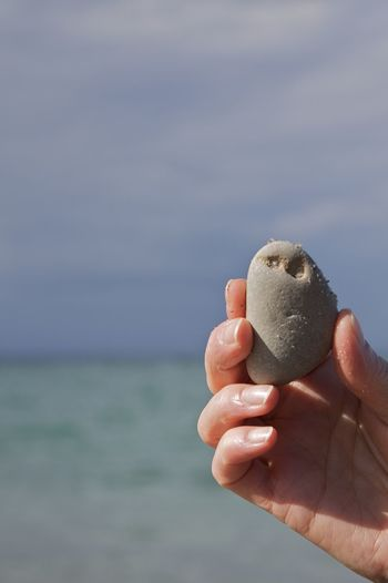 A grumpy stone found at Heiligendamm, Baltic Sea, Germany. A Day At The Beach Baltic Sea Blue Faces In Nature Faces In Things Found Funny Faces Grey Grumpy Hand Holding Horizon Over Water Human Hand Ocean Outdoors Sea Stone Stones Stones & Water