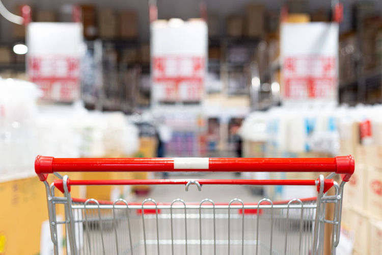 Close-up of red shopping cart in supermarket