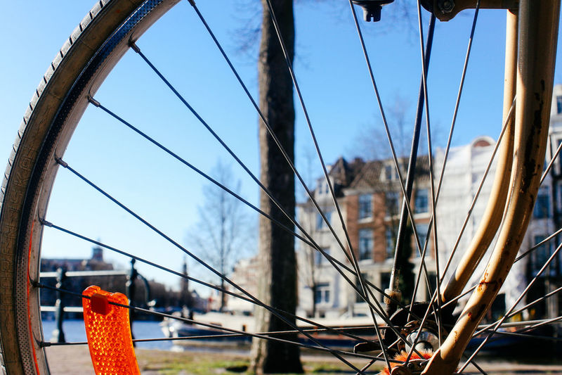 Close-Up Of Bicycle Against City Building