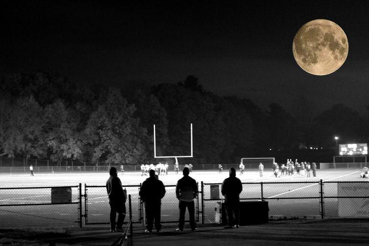 Men at night against sky
