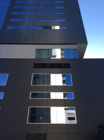 Texas blue sky Modern Architecture window reflections Strong October Sunlight contemporary building textures High Rise Building USA