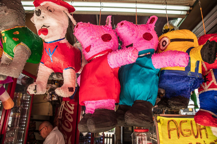 Full length of toys for sale at market stall