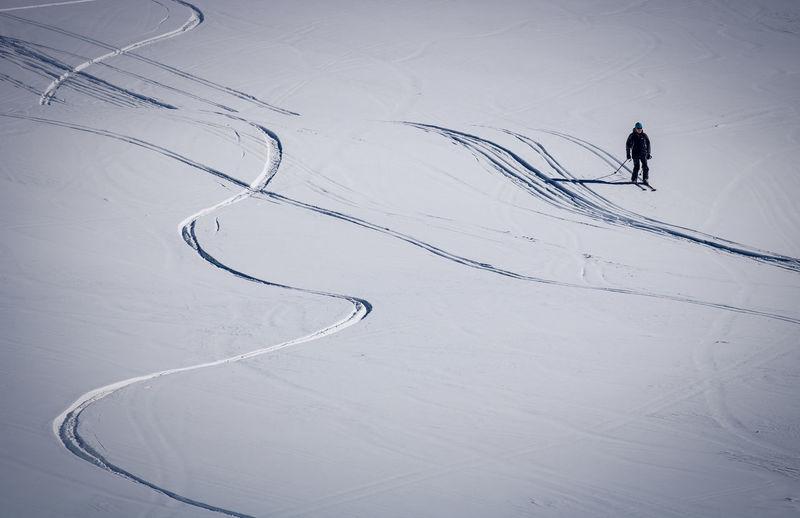 High Angle View Of Man Skiing On Snow