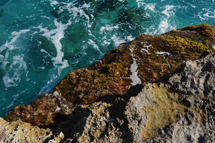 High angle view of rock formations at shore