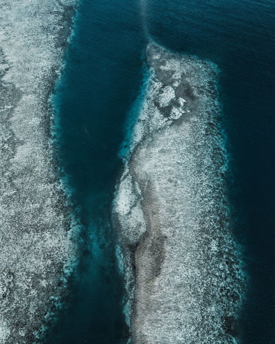 Aerial View Of Rock Formation By Sea