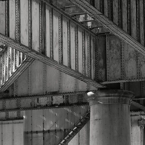 Abandoned Pier at Greenwich Power Station Detail of the light coming through the former pier at Greenwich Power Station. The pier was used to bring in coal and remove ash from the old boilers but nowadays the station uses gas so the pier has been left to rust. Greenwichpowerstation Greenwich London Details Blackandwhite Blacknwhite Grittyprettylondon Silver  50shadesofgrey Pier Beams Tpro_ldn Tpro_ldn_abandoned London4all London_enthusiast Fujixt10