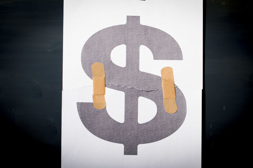 Currency symbols and band-aids, economic crisis and economic recovery Business Crash Damage Economic Decay Recession Band Aid Bankrupt Close-up Crisis Debt Debt Crisis Dollar Economic Economic Crisis Economic Growth Failure  Finance And Economy Financial Problem Protection Repair Symbol Tearing