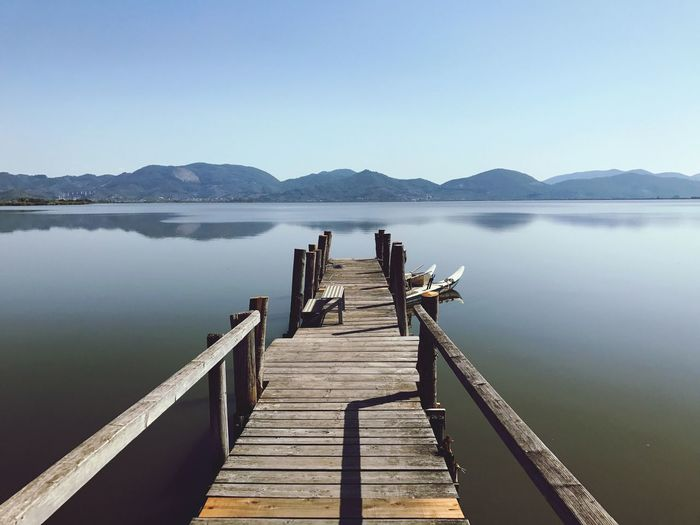 Wood - Material Pier Lake Mountain Water Jetty Nature Tranquility Wood Paneling Tranquil Scene Clear Sky Beauty In Nature Scenics Mountain Range No People Outdoors Day Sky