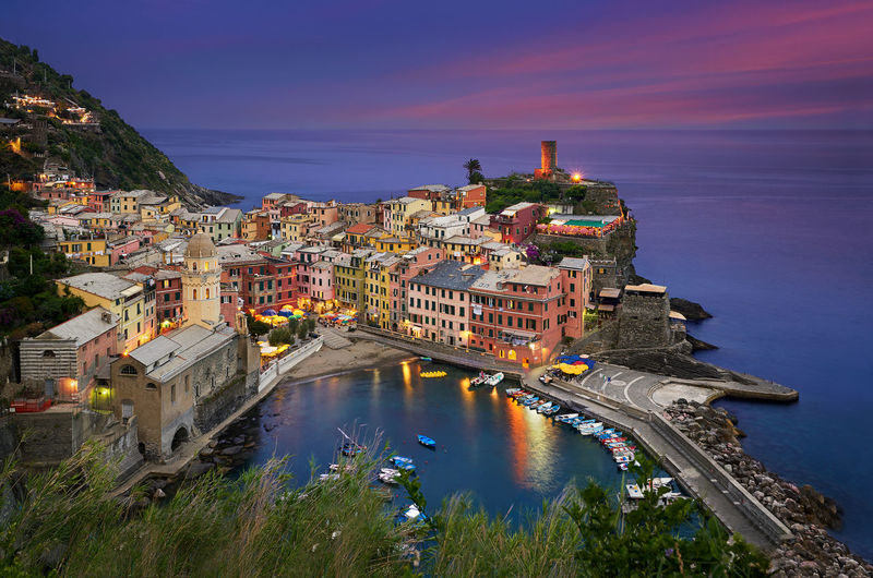 Vernazza is one of the five towns that make up the Cinque Terre region, located in the province of La Spezia, Liguria. This photo was taken on the Summer of 2016. Aerial View Architecture Beach Boats Calm Cinque Terre City City Life Cityscape Europe Evening Iconic Italy Landmark Landscape Liguria Marina Nightscape Panorama Peace Relaxing Seascape Sunset Travel Vernazza The Great Outdoors - 2017 EyeEm Awards The Architect - 2017 EyeEm Awards
