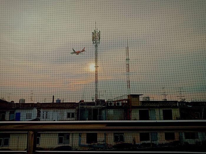 Cityscape against sky seen through airplane window