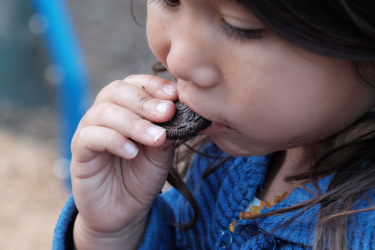 Close-up of girl eating cookie