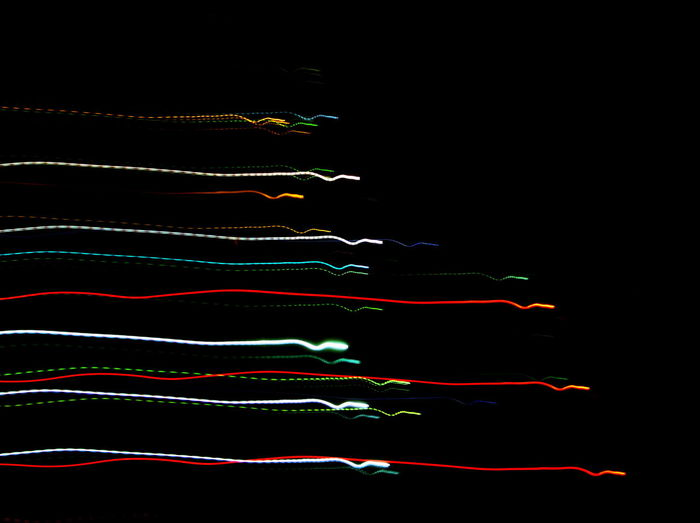 Abstract lights over black background
