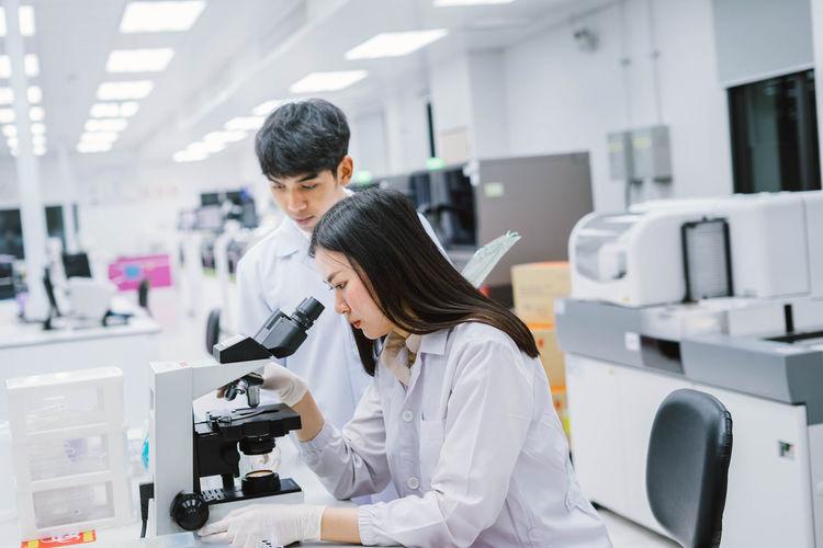Scientist examining specimen in laboratory
