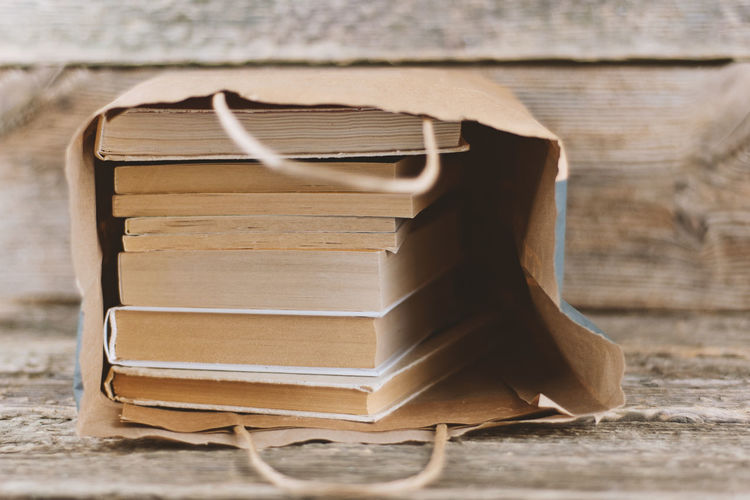 Close-up of old books in paper bag