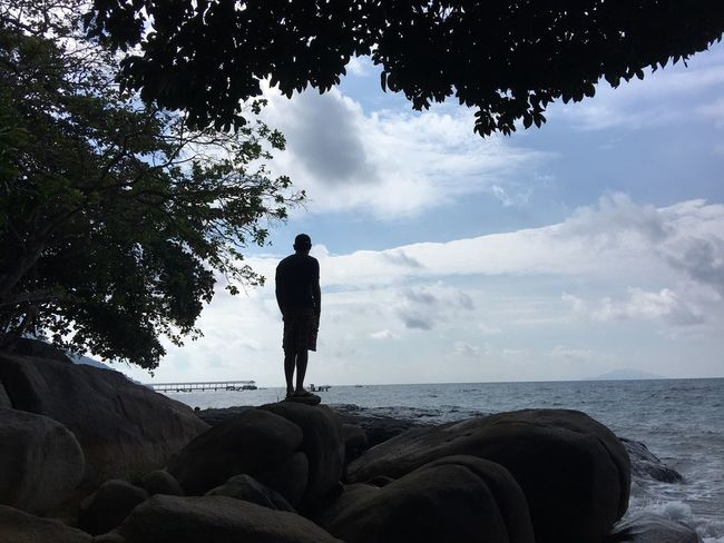 Lost In The Landscape One Person Sea Real People Full Length Standing Nature Sky Water Tranquil Scene Beauty In Nature Scenics Tree Leisure Activity Men Horizon Over Water Tranquility Day Outdoors Lifestyles Silhouette