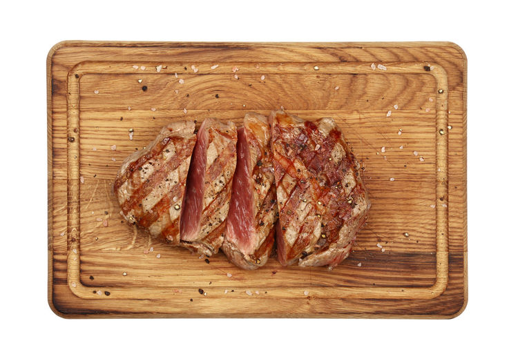Close up medium rare sliced beef steak on wooden board isolated on white background Food Food And Drink Meat Freshness Cutting Board Wood - Material Cut Out No People White Background Studio Shot Red Meat Healthy Eating Directly Above Ready-to-eat Beef Close-up SLICE Steak Beef Steak Beefsteak Medium Rare Cut Portion Serving Size Serving Food And Drinks Copy Space