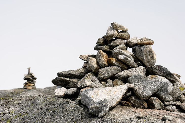 Close-up of stack of rocks against clear sky