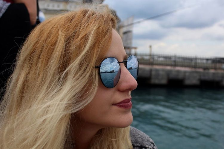 EyeEm Selects Sunglasses Sunglasses Reflection Sun Glasses Istanbul Blond Hair One Person Young Adult Young Women Long Hair Portrait One Young Woman Only Outdoors Sky Day One Woman Only Close-up Adult People Adults Only Sea Sea And Sky The Week On EyeEm