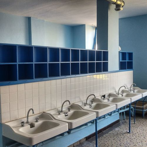 Empty chairs in bathroom