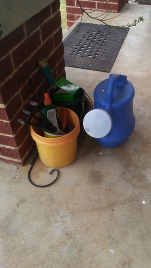Gardening tools. Boots N Jeans Gal💝 Just Be Me 💎💙💎 Hello World ESSENTIALS........ Still Shot Setting Fresh Oklahoma Happy Head Shot  EyeEm EyeEm Best Shots EyeEmNewHere Ray Of Sunshine Cowgirl Eye4photography  Front Porching Sand Pail And Shovel High Angle View Watering Can Sand Bucket