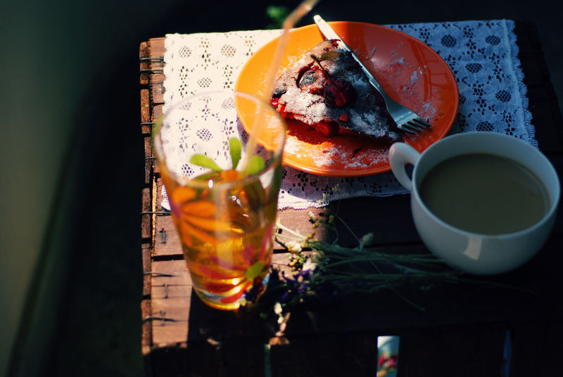 A slice of cherry cake in a plate with coffee and fresh juice on rustic wooden background Bake Bakery Cherry Cake Chery Coffee Crumble Cup Dessert Drink Food Food And Drink Freshness Fruit Glass Homemade Juice Pie Plate Recipe Red Refreshment Rustic Slice Of Cake Sour Table