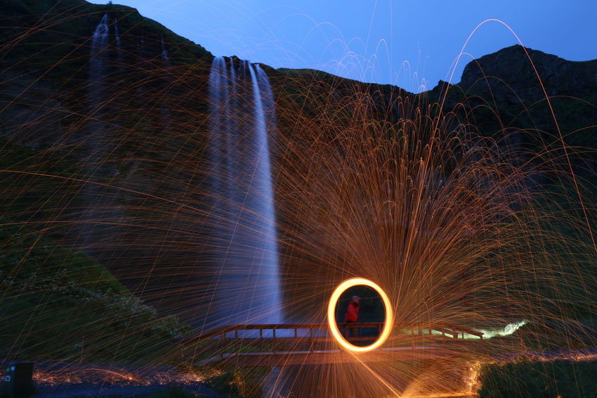 Cold Fire Circles, Iceland Light North, Sparks Waterfall Blurred Motion Clear Sky Europe Evening, Illuminated Long Exposure Motion Nature Night One Person Outdoors People Play Of Light Real People Sky Speed Water Wire Wool