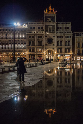 The Art Of Street Photography Night Illuminated Building Exterior Architecture Built Structure City Reflection Water Real People Street Travel Destinations Travel City Life Outdoors Venice Venice, Italy Sanmarco Acquaalta San Marco Square