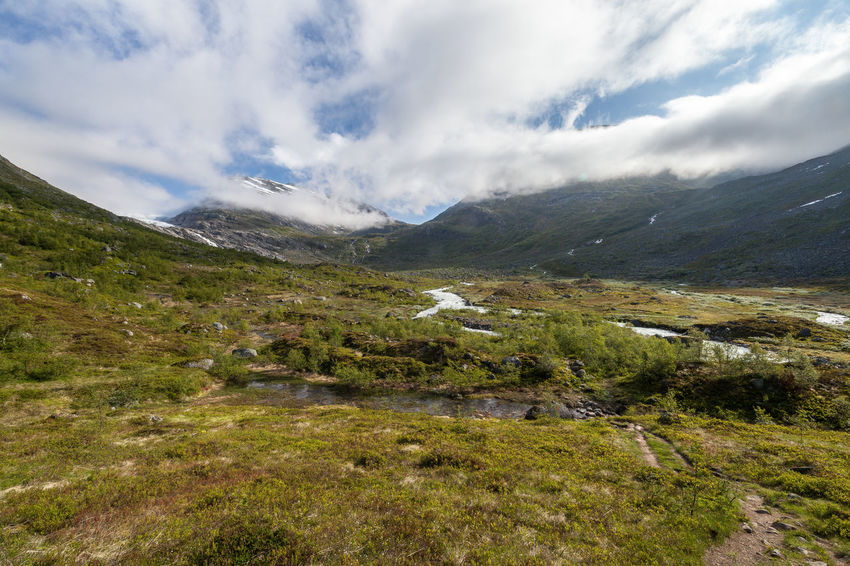 Hiking Norway Beauty In Nature Cloud - Sky Day Environment Grass Green Growth Hiking Adventures Land Landscape Mountain Mountain Peak Mountain Range Nature No People Outdoors Scenery Sight Sky Snowcapped Mountain The Way Forward Water Wilderness