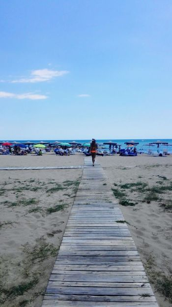 Showcase July San Felice Circeo Italy Beach Woman Sea And Sky Sand Seascape Summer On The Beach Beachphotography Wood - Material Hanging Out Way Way To The Beach Orange People Capture The Moment People And Places