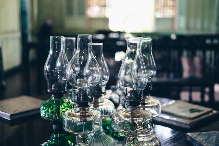 Close-up of wine glass with bottles on table