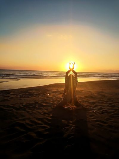 Sunset Sea Sky Reflection Beach Silhouette One Person Nature Human Body Part People Adult Tranquility Water Travel Destinations Horizon Over Water Outdoors Nature Goodvibes Happiness Yoga Yogapractice Namaste ❤ Girl Yoga Training Artistic Photo