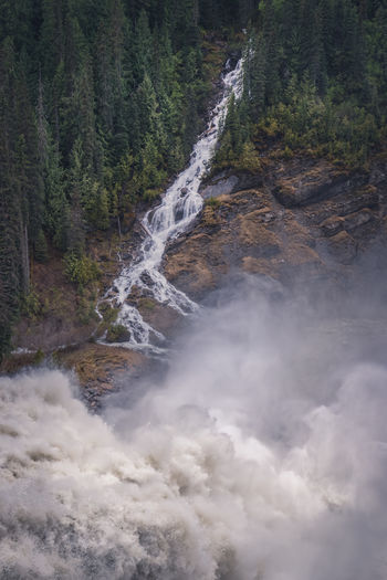 """The greatest danger in times of turbulence is not the turbulence; it is to act with yesterday's logic"" Peter Drucker Down a lonely dirt road to an unmarked stop, the Morkill river rages with the spring melt. The sheer volume of water flowing in front of you as you stand on the edge of the upper falls warps your perspective and creates a swirling sensation like you're going to be sucked into a vortex. If you can draw your eyes from the mesmerising flow in front of you two other significant waterfalls, which seem tiny in comparison, also majestically flow down into the drop here. I have done my best to capture one here along with the main fall, but you would need a drone to get the full perspective of the scene. We scrambled down some very slippery mossy cliffs to the bottom of the falls however the spray blocked any view from down at the river. It continues to amaze me how many places like this are lurking in Northern British Columbia, that in other countries would be considered national treasures and overrun with development and tourists, yet here are just sitting mostly unnoticed at the end of dirt forestry roads. We camped here the night and did not see another soul, unless you count the black bear which was wandering around the falls. Love Life, Love Photography Morkill River Raging River Beauty In Nature Canada Day Environment Flowing Flowing Water Forest Large Volume Long Exposure Massive Waterfall Motion Nature No People Non-urban Scene Northern British Columbia Outdoors Plunging Power In Nature Scenics - Nature Spray Tranquility Water Waterfall"