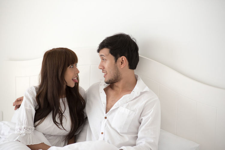 Adult Bonding Boyfriend Couple - Relationship Emotion Face To Face Falling In Love Girlfriend Heterosexual Couple Indoors  Love Men Positive Emotion Romance Togetherness Two People Waist Up Women Young Adult Young Couple Young Men Young Women