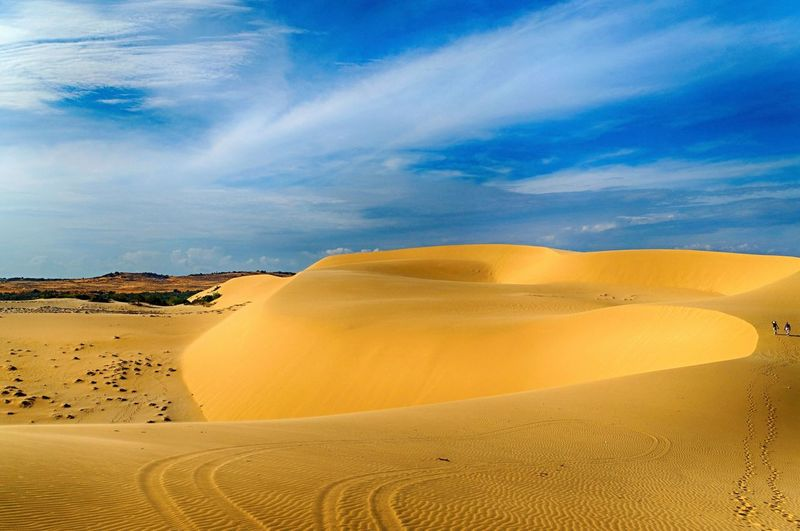 Scenic View Of Desert Against Dramatic Sky