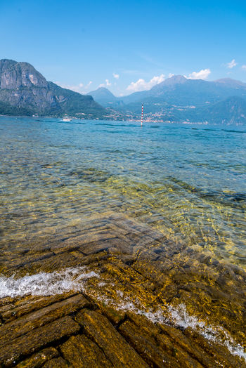 Italy Como Como Lake Lago Di Como Lago Di Como, Italy Water Beauty In Nature Sky Scenics - Nature Sea Tranquility Tranquil Scene Mountain Nature No People Day Non-urban Scene Beach Idyllic Blue Land Mountain Range Outdoors Remote Shallow