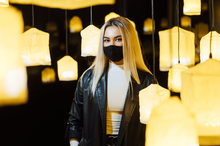 Woman standing in illuminated store