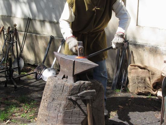Blacksmith manually forging the molten metal with hammer on the anvil . Photo taken during outdoor public event (no ticket required) in public place . Pistoia, Italy Anvil Blacksmith  Craft Craftsman Farrier Forge  Forging Glowing Hammer Hand Handmade Heavy Hot Incandescent Iron Ironwork  Manual Worker Metal Metalwork Molten Rod Smith Spark Traditional Work