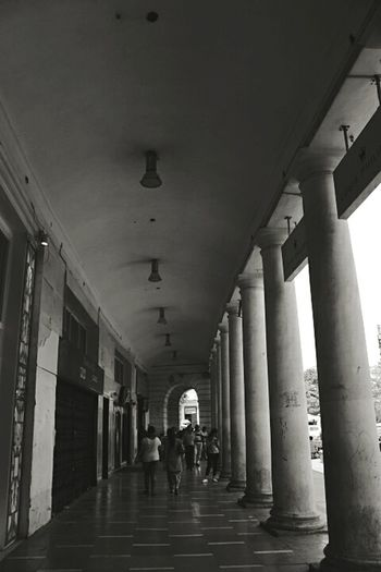 Full Length Indoors  Walking History Corridor Architectural Column Silhouette Architecture Built Structure City Day Check This Out Hot Day New Delhi,india May 2017 The Architect - 2017 EyeEm Awards The Great Outdoors - 2017 EyeEm Awards EyeEmNewHere Building Exterior Cannaught Place