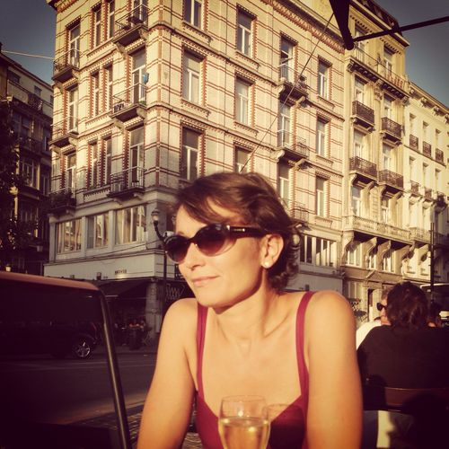 Girl on a sunny terrace in Brussels