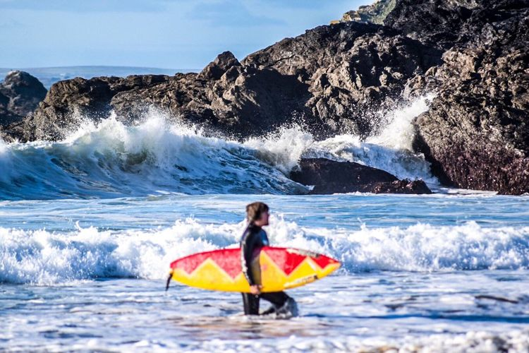 Awesome surf Year Round Sports Autumn Water Sport Surfboard Surfer One Person Outdoors Motion Day Full Length Adventure Rock - Object Leisure Activity Nature Water Sky Sea Beauty In Nature Wave Summer Sports A New Beginning This Is Strength Autumn Mood