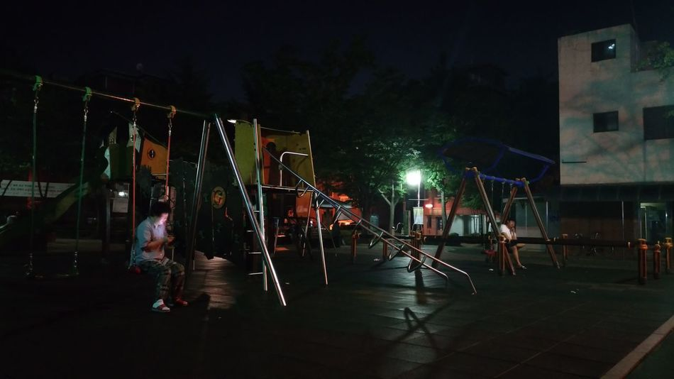 Night Streetview Child Playground Illuminated Tree Walking In The Park Darkness And Light People And Places No Children Playing Live For The Story The Street Photographer - 2017 EyeEm Awards